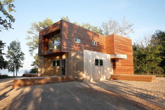 Logge e case in legno for Costare la costruzione di una casa contro l acquisto